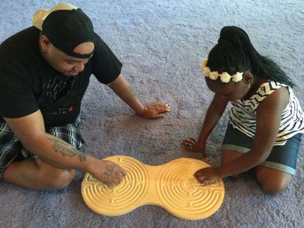 dad and daughter with maple Chartres Intuipath double finger labyrinth