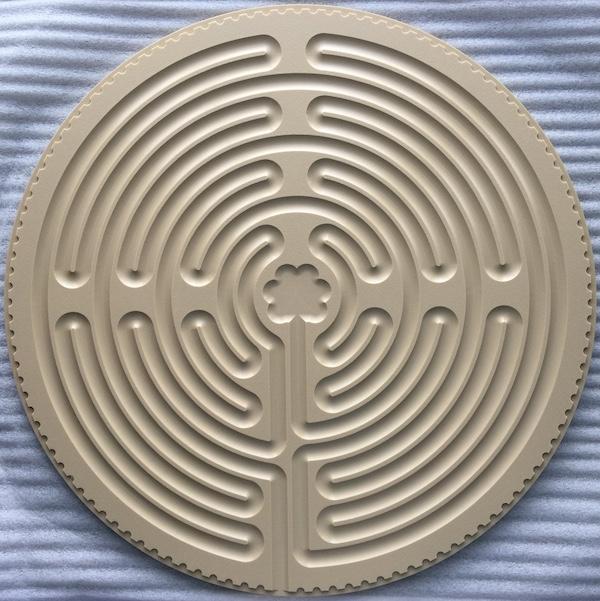 tan plastic Chartres labyrinth
