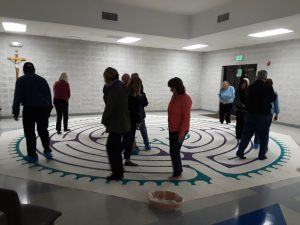 churchgoers enjoying Chartres Essence canvas labyrinth