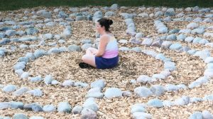 Relax4Life walking labyrinths-girl meditating in the center of the Roman